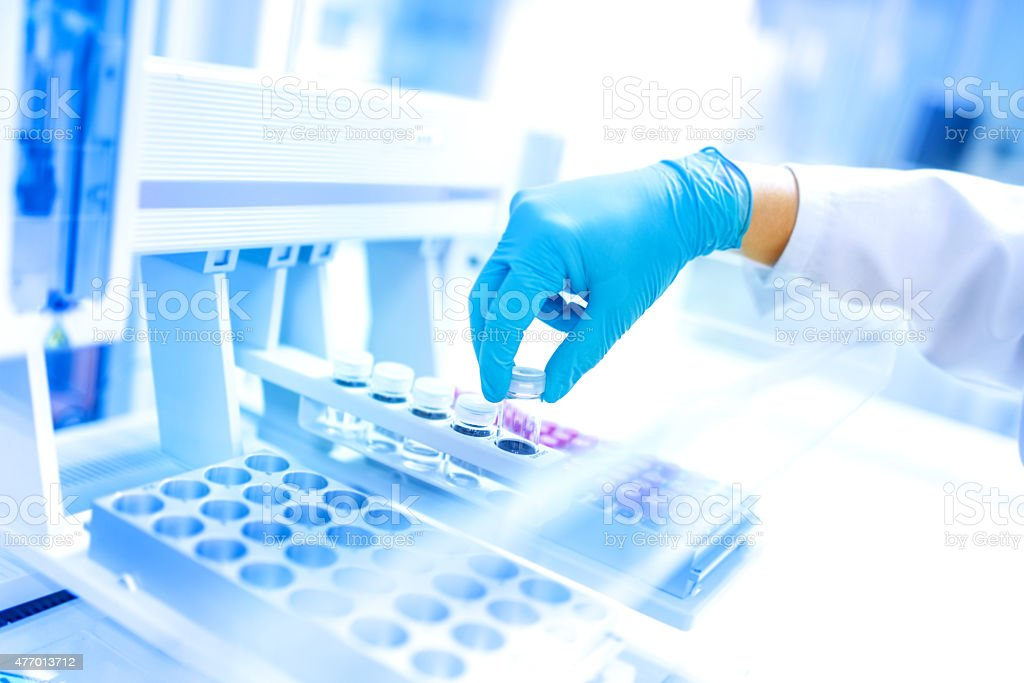 Scientist using protective robber gloves for handling substances and experiments stock photo