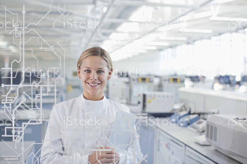 Scientist using touch screen in lab royalty-free stock photo