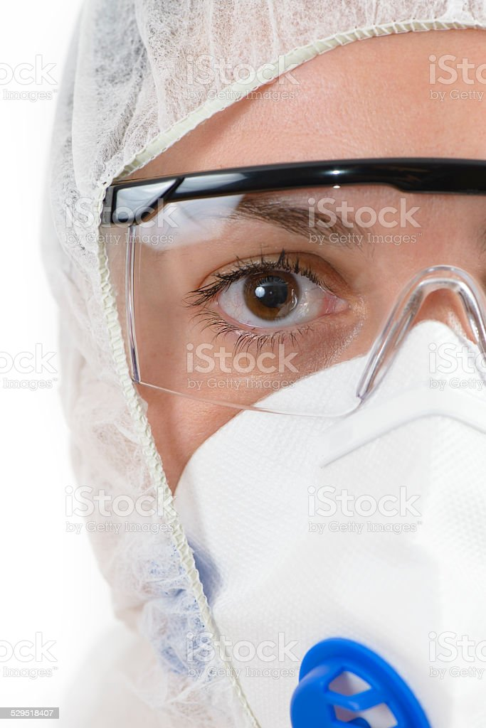 Scientist wearing protective suit stock photo