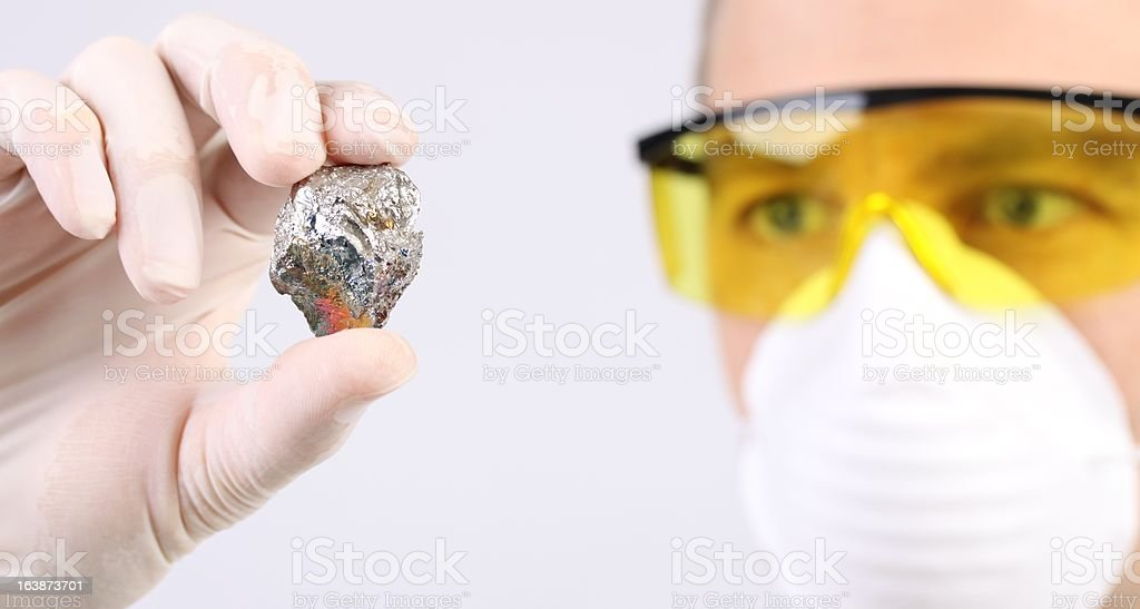 Scientist with a sample of metal royalty-free stock photo