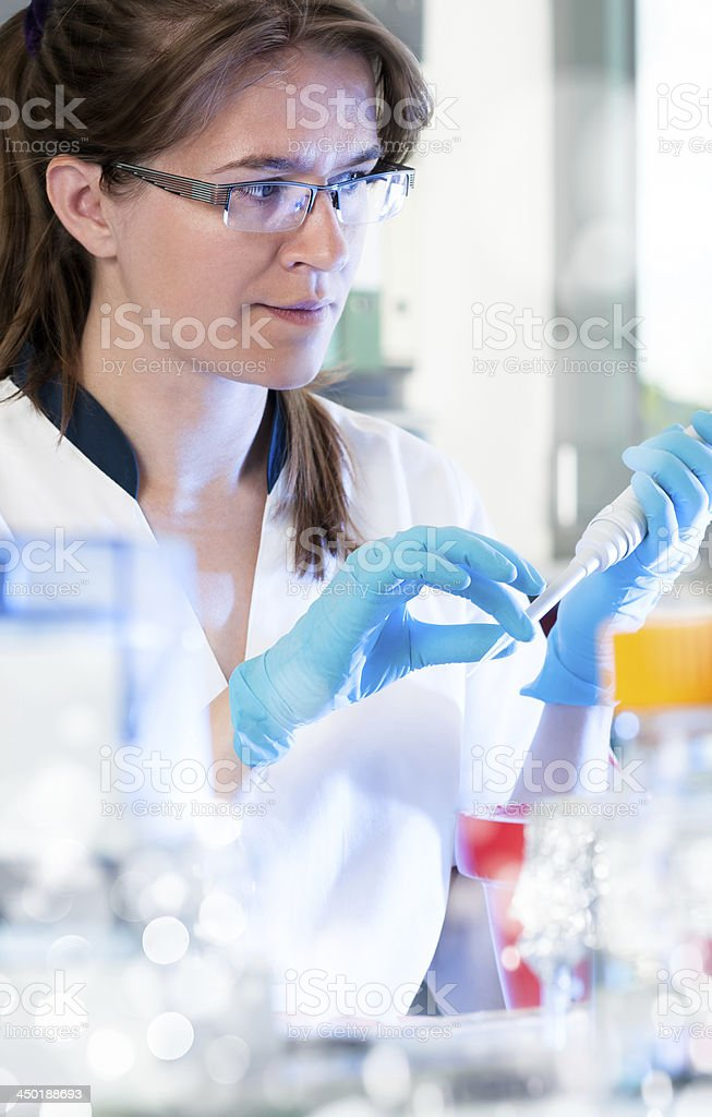 Scientist with automatic pipette stock photo
