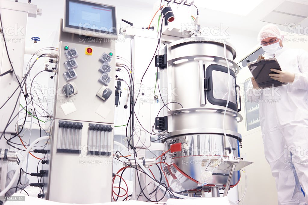 scientist with bioreactor stock photo