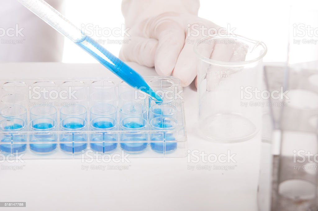 scientist with equipment and science experiments stock photo