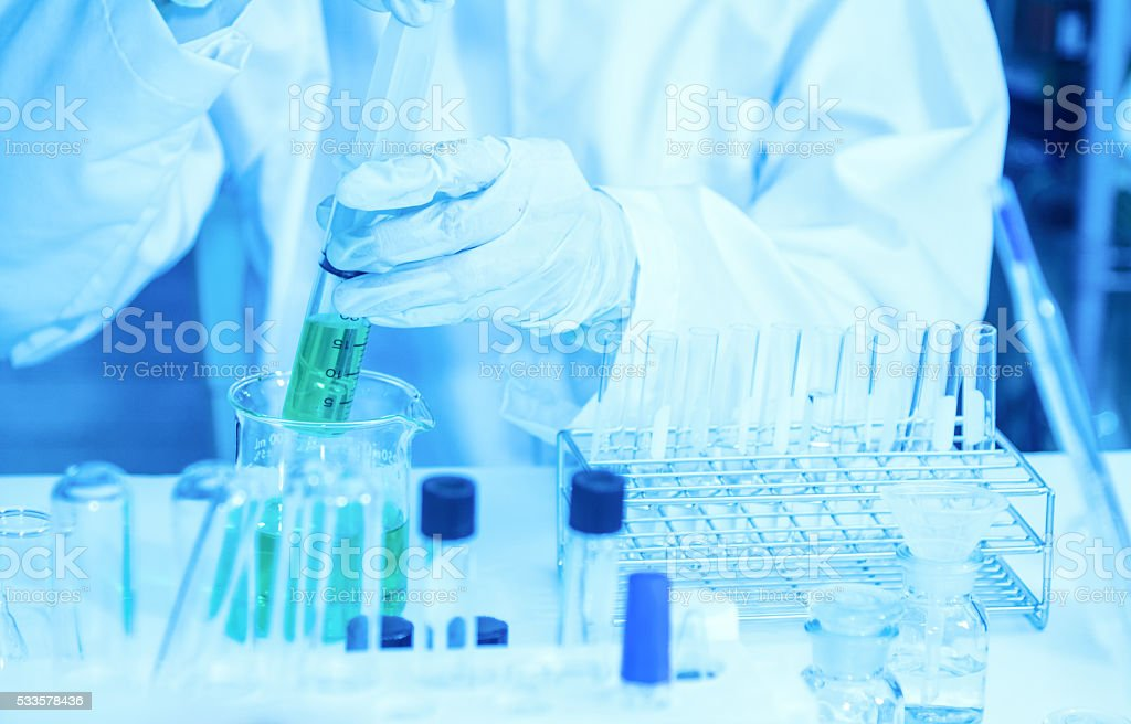 Scientist with equipment laboratory for science concept. stock photo