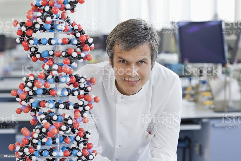 Scientist with molecular model in lab royalty-free stock photo