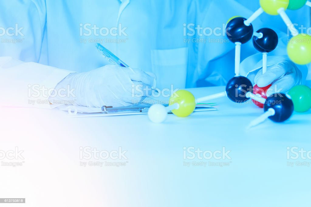 Scientist with molecule model and science concept. stock photo