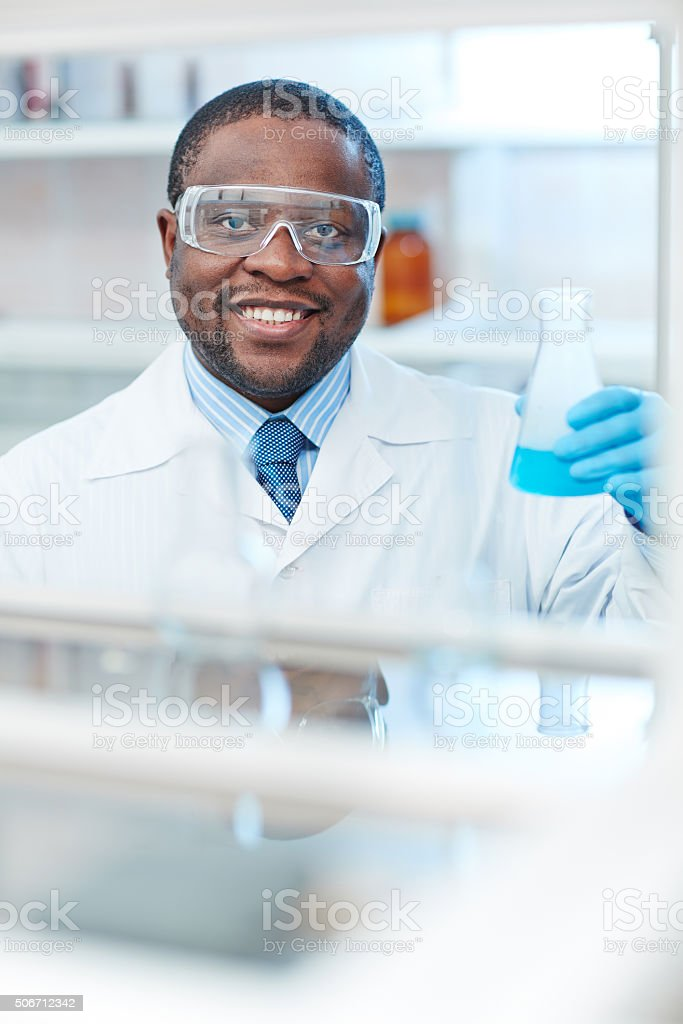 Scientist with tube stock photo