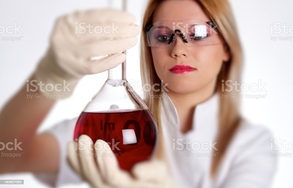 Scientist Woman Analyzing Red Liquid royalty-free stock photo