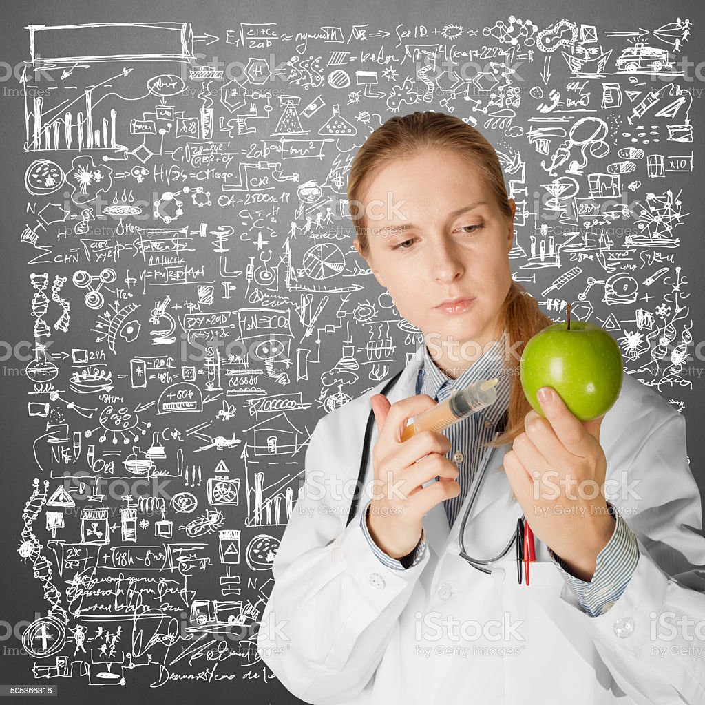 scientist woman with apple stock photo