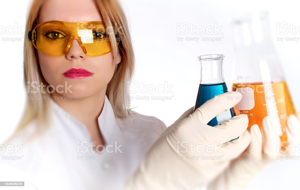 Scientist Woman With Colorful Chemical Liquids royalty-free stock photo