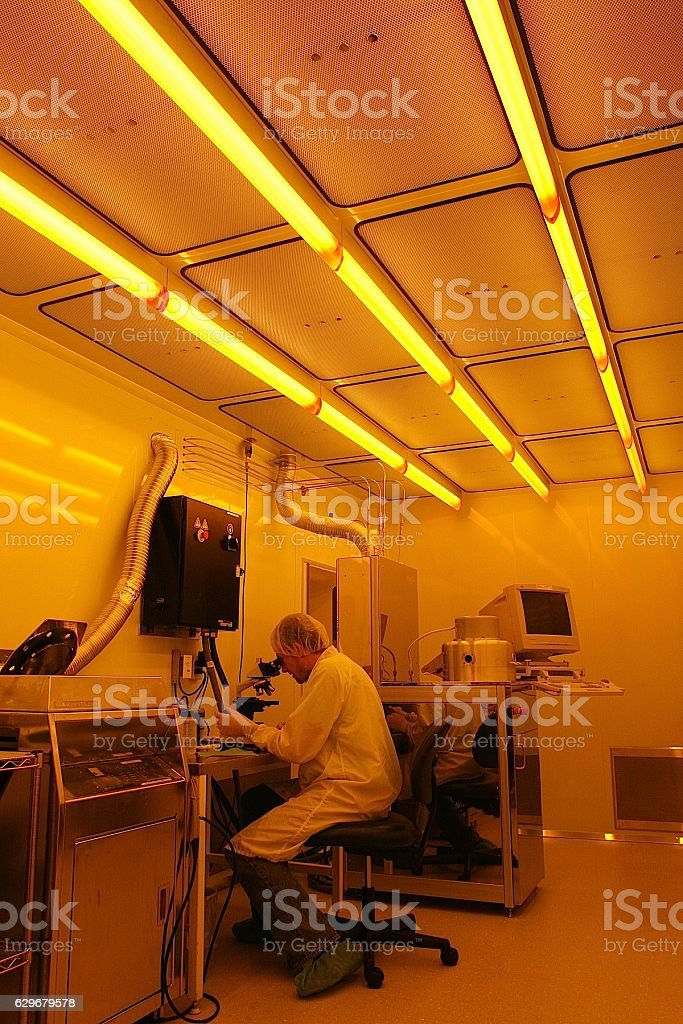 Scientist working in clean-room of a laser laboratory stock photo