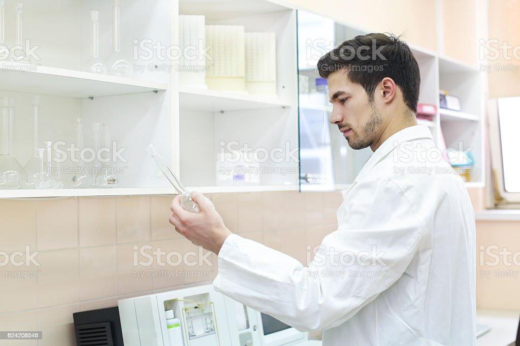 Scientist working in lab stock photo