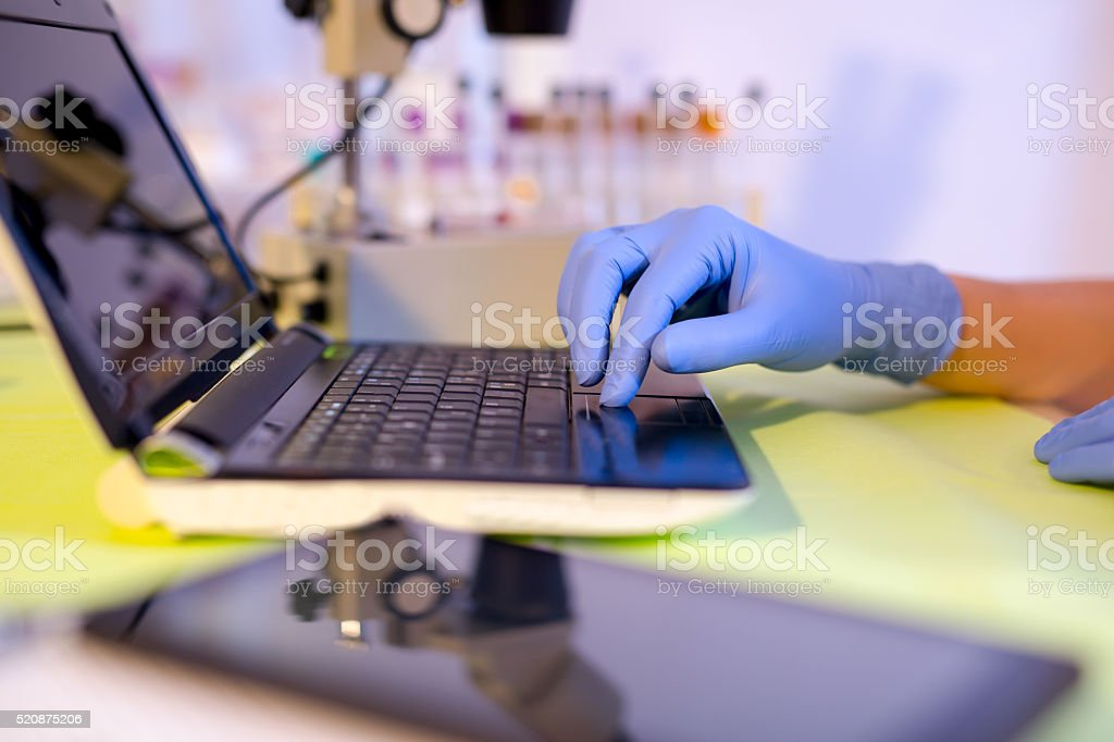 Scientist working in the laboratory on a laptop stock photo