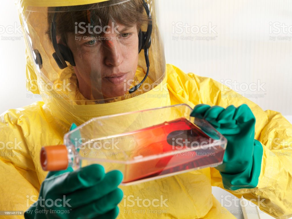 Scientist working under high security enviroment in laboratory stock photo
