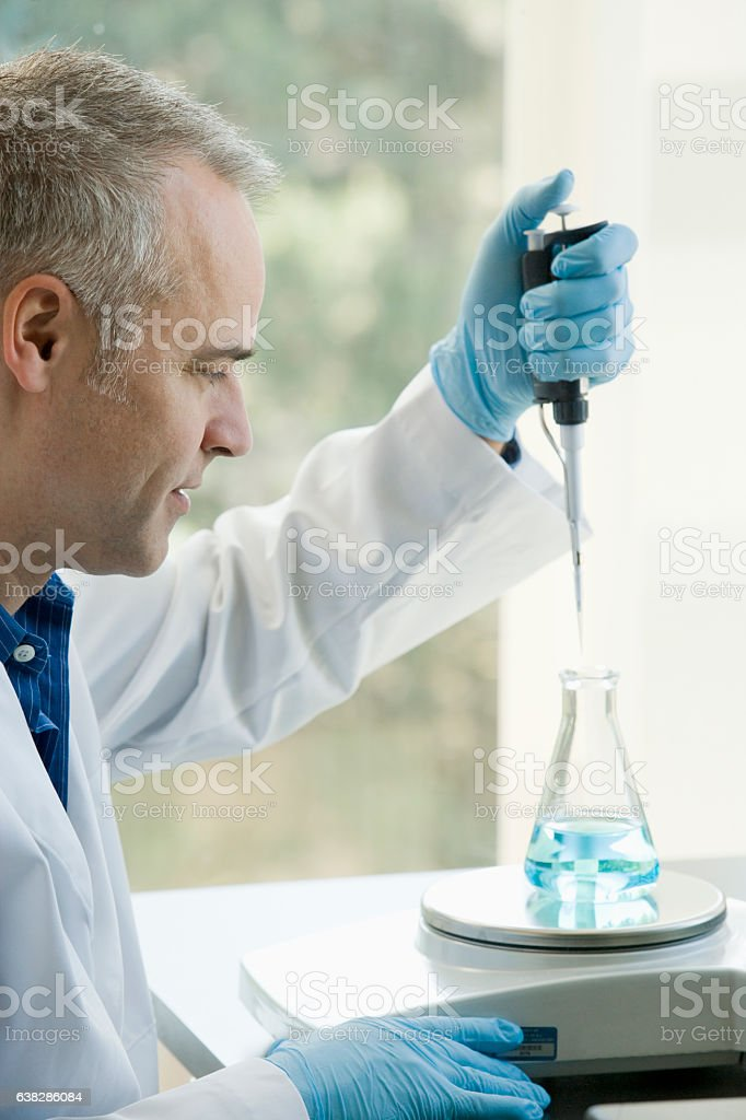 Scientist working with experiment in laboratory stock photo