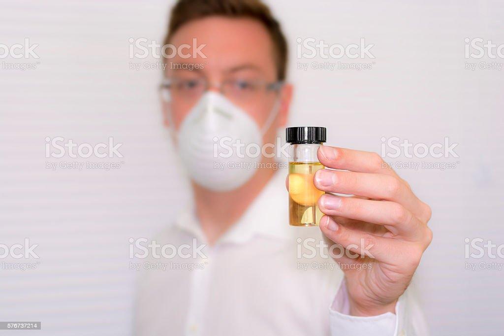 Scientist/Doctor Holding Urine Test Bottle stock photo