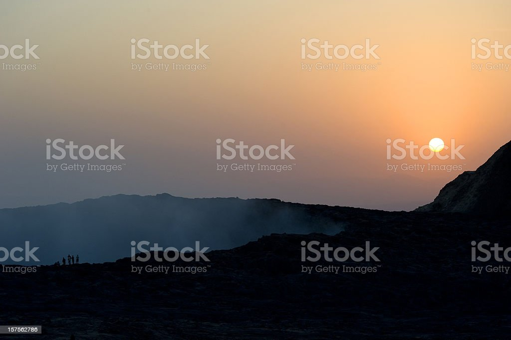 Scientists are looking into the crater of Erta Ale vulcano stock photo