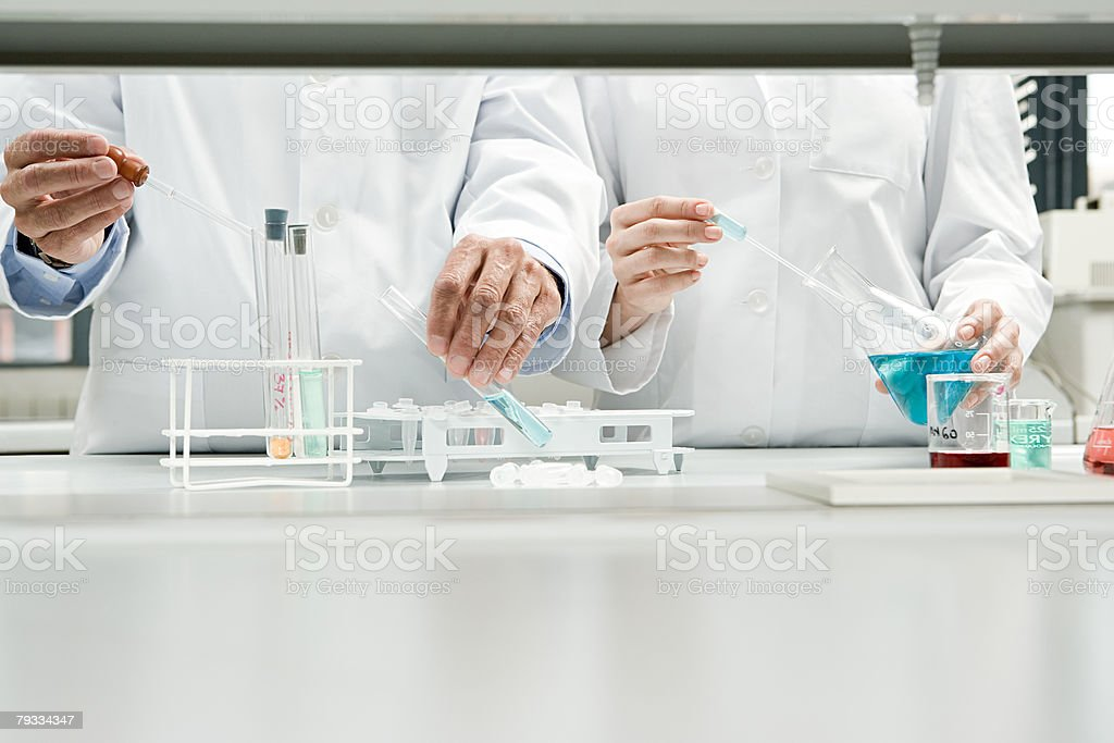 Scientists conducting an experiment stock photo