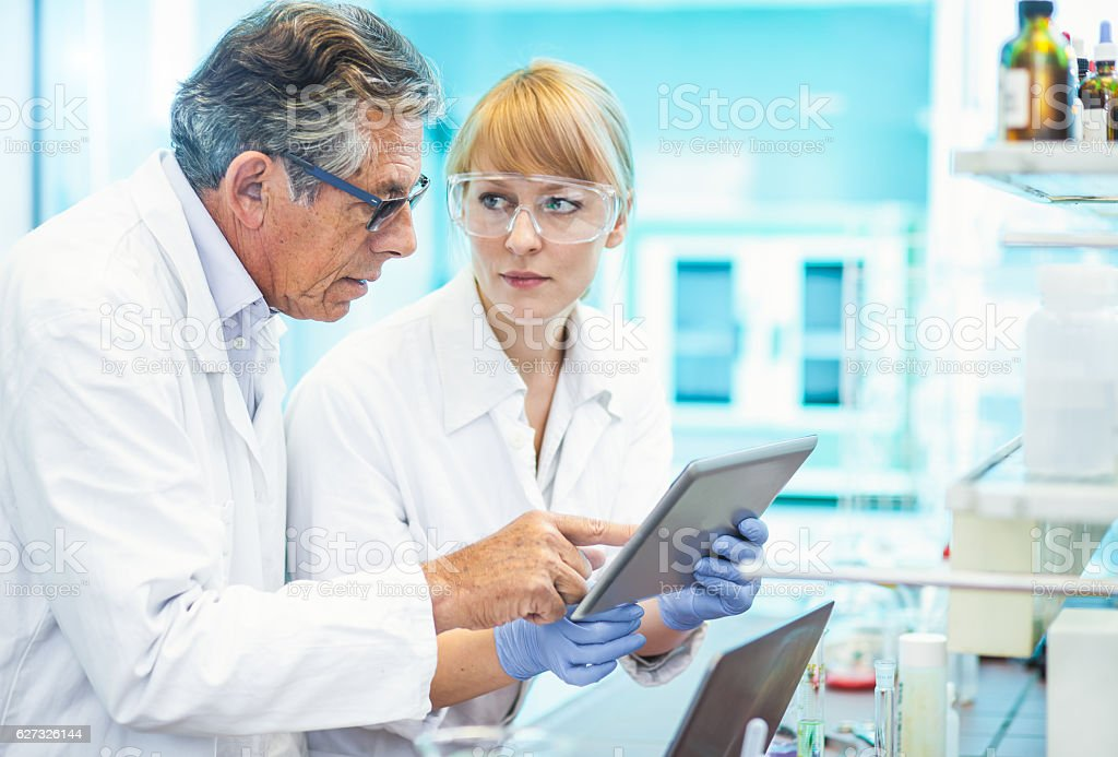 Scientists Discussing and  Using Computer Software stock photo