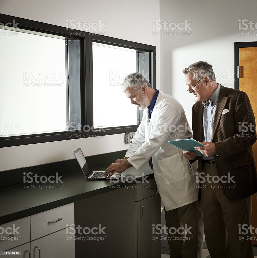 Scientists in an Observation Room royalty-free stock photo