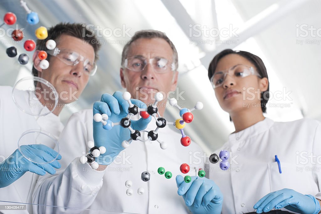 Scientists making molecular model in lab stock photo