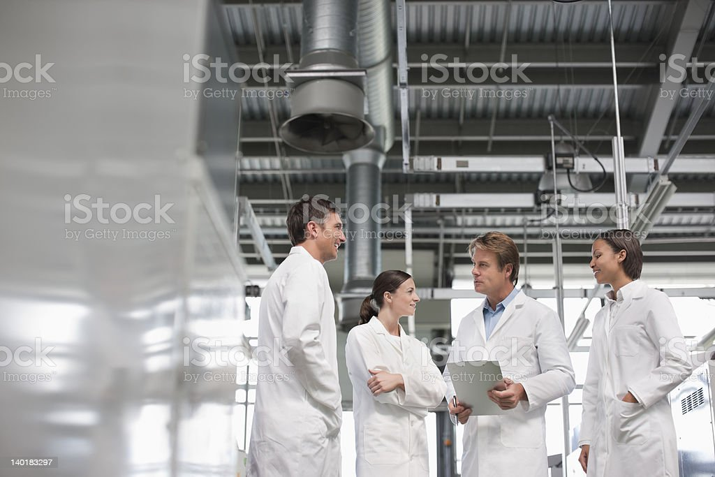 Scientists meeting in laboratory royalty-free stock photo