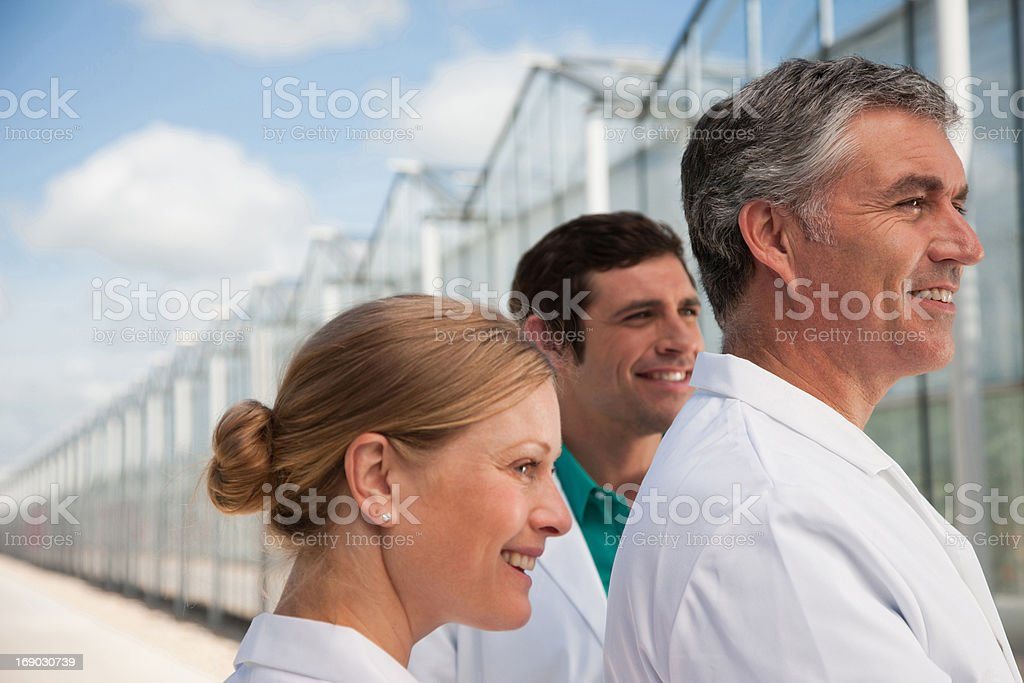 Scientists outside greenhouse royalty-free stock photo