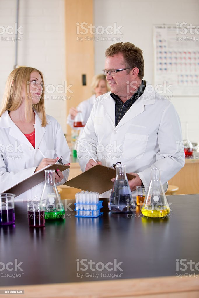 Scientists Record Results From Experiment royalty-free stock photo