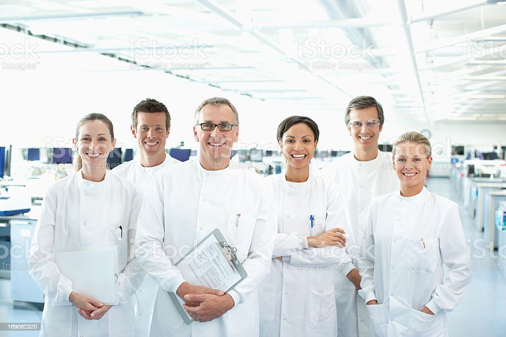 Scientists smiling together in lab stock photo