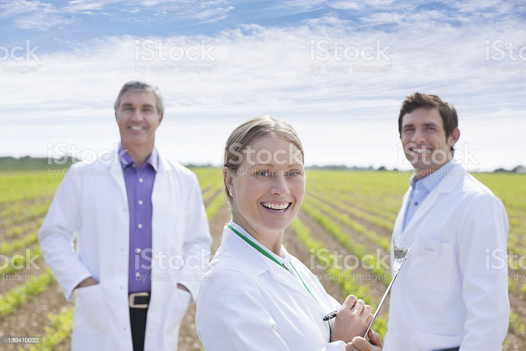 Scientists standing in field royalty-free stock photo
