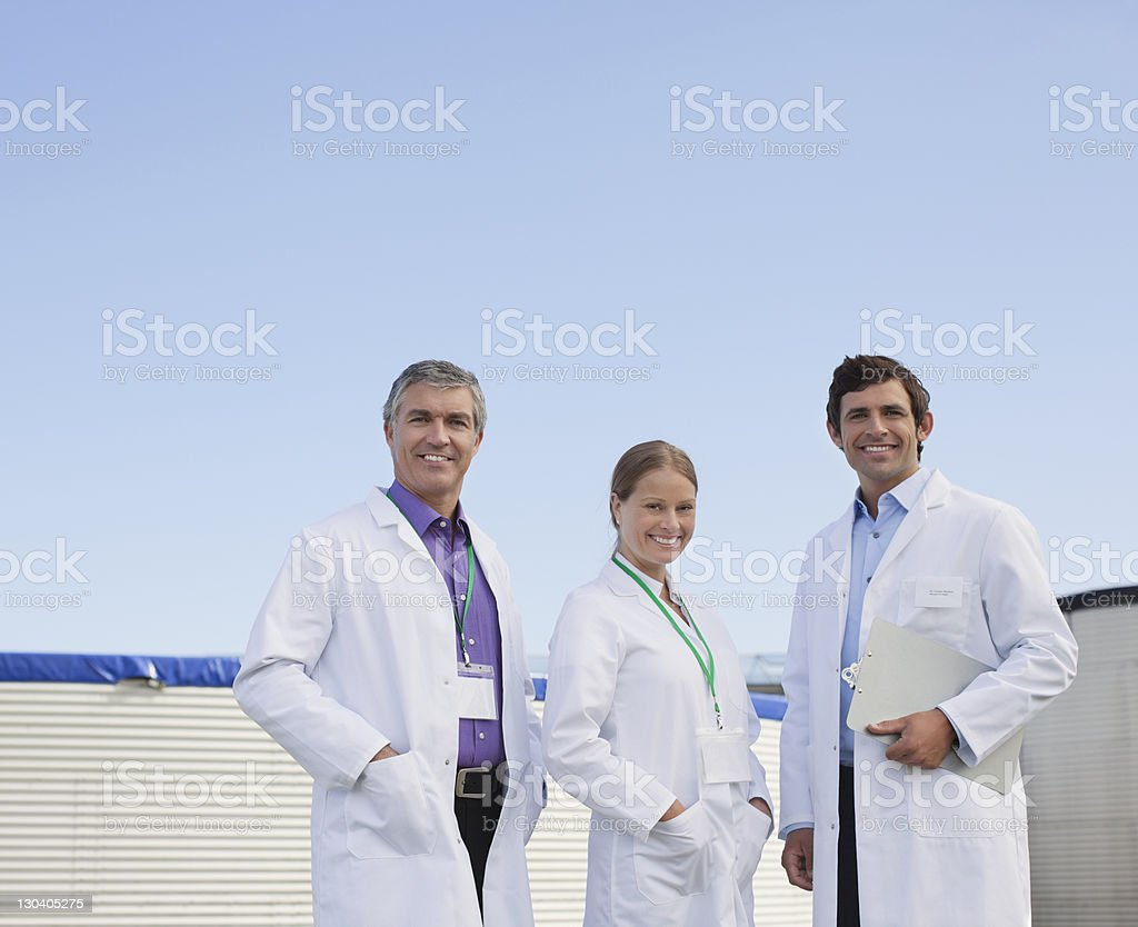 Scientists standing together outdoors royalty-free stock photo