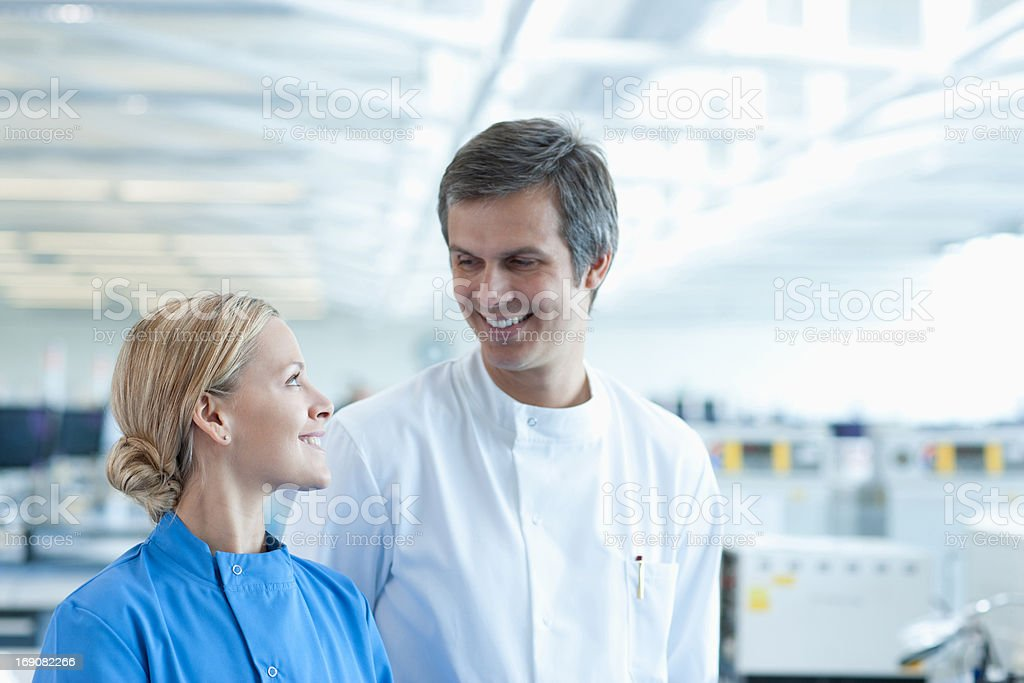 Scientists talking in lab royalty-free stock photo