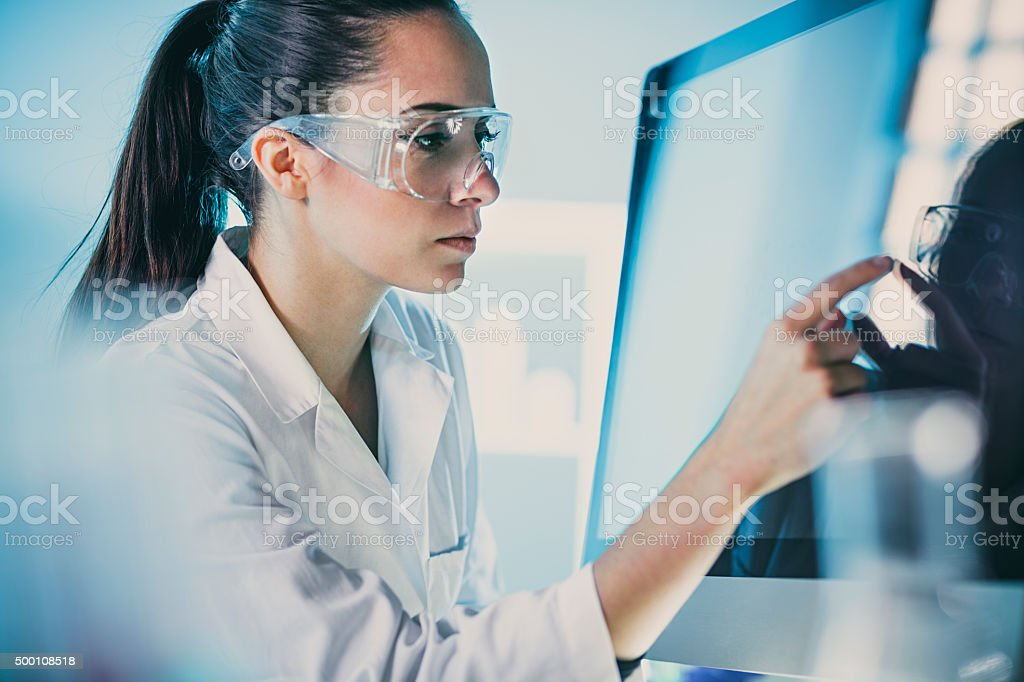 scientists  uses modern technology for its  research stock photo