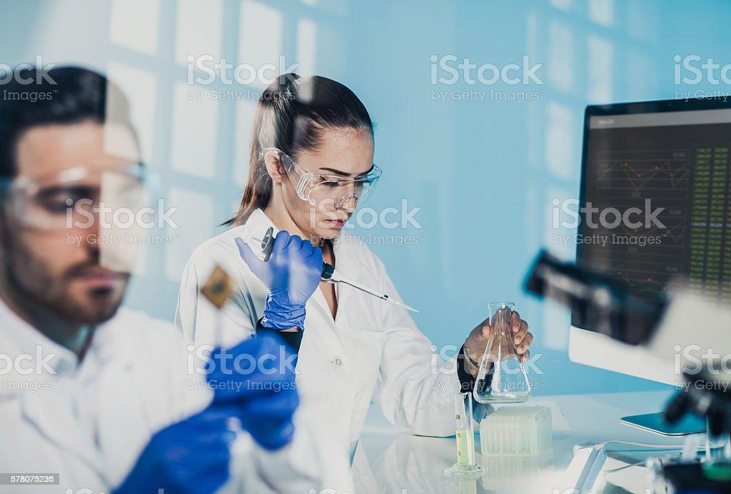Scientists Using Lab Glassware stock photo