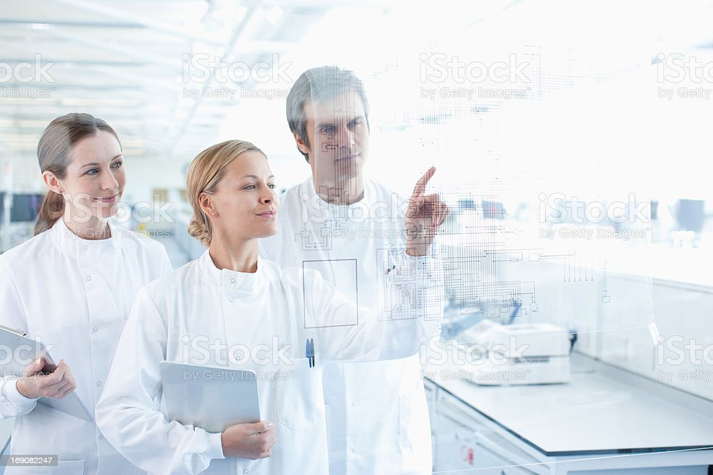 Scientists using touch screen in lab stock photo