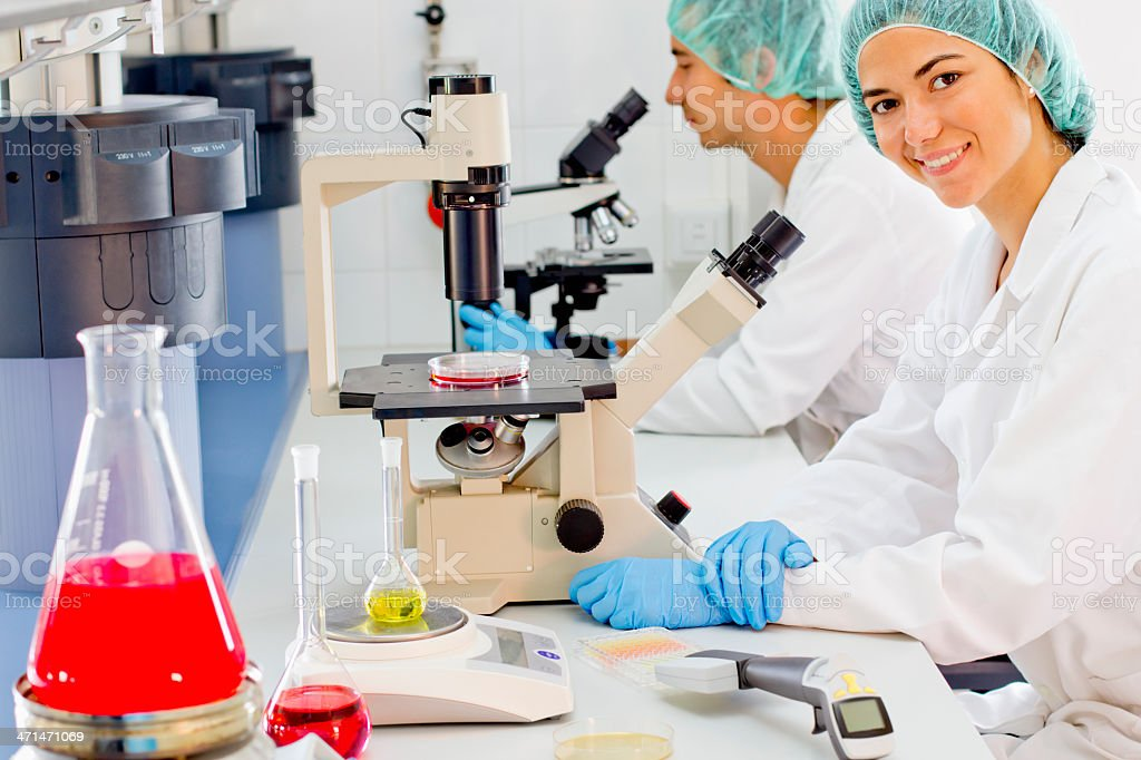 Scientists working at a pharmaceutical laboratory royalty-free stock photo