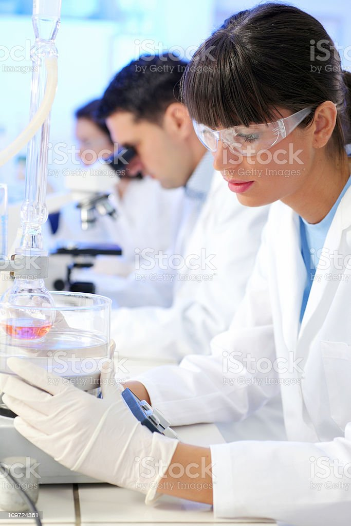 Scientists working in a chemical lab royalty-free stock photo