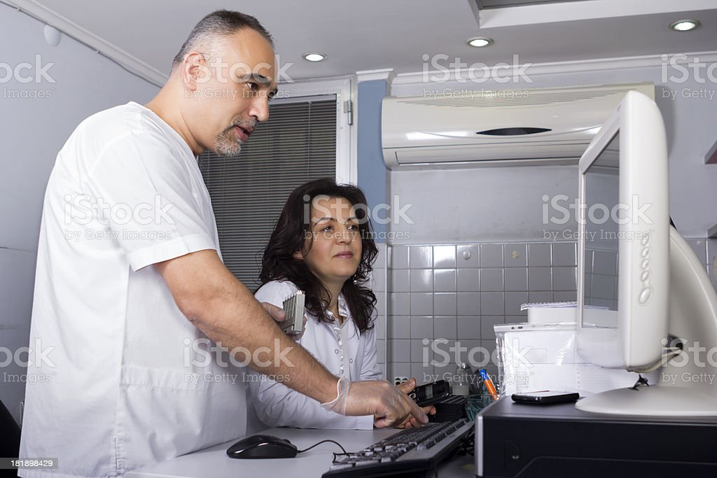 Scientists working in laboratory royalty-free stock photo