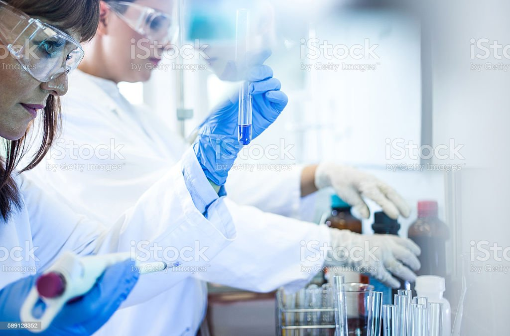 Scientists Working in the Digestorium stock photo