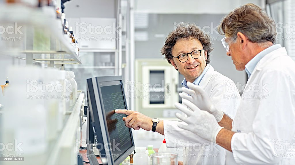 Scientists working on computer in a lab stock photo