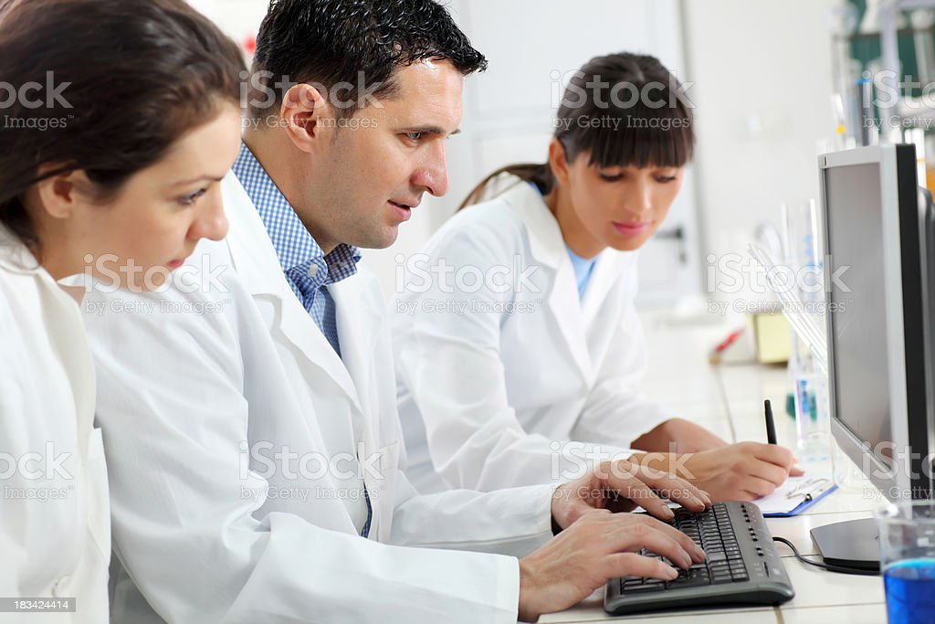 Scientists working on computer in the laboratory. royalty-free stock photo