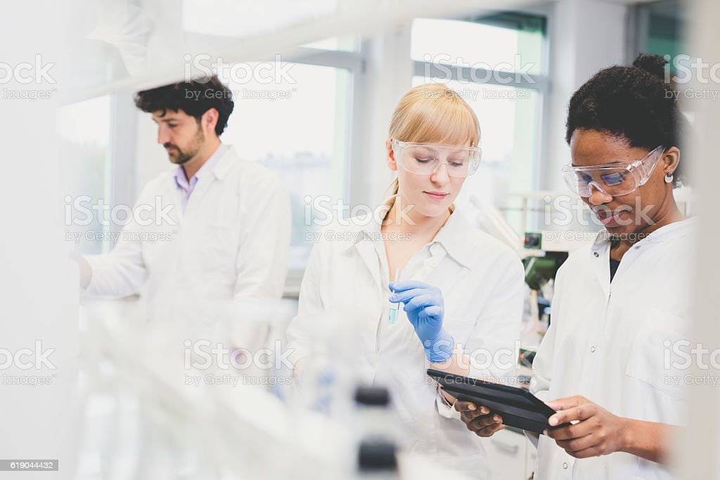 Scientists working together in lab stock photo