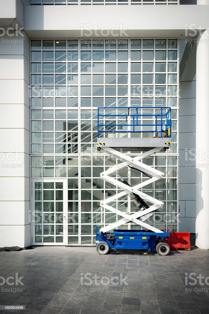 scissor lift for window cleaning stock photo
