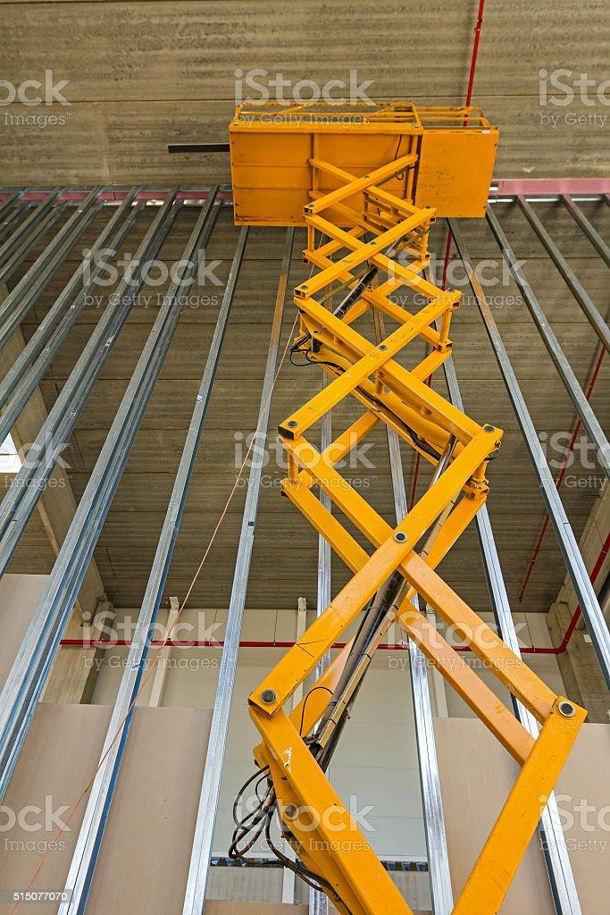 Scissor lift platform on a construction site. stock photo