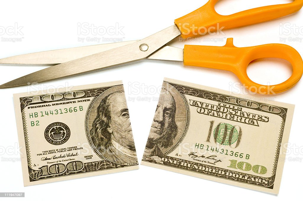 Scissors and Divided Benjamin royalty-free stock photo