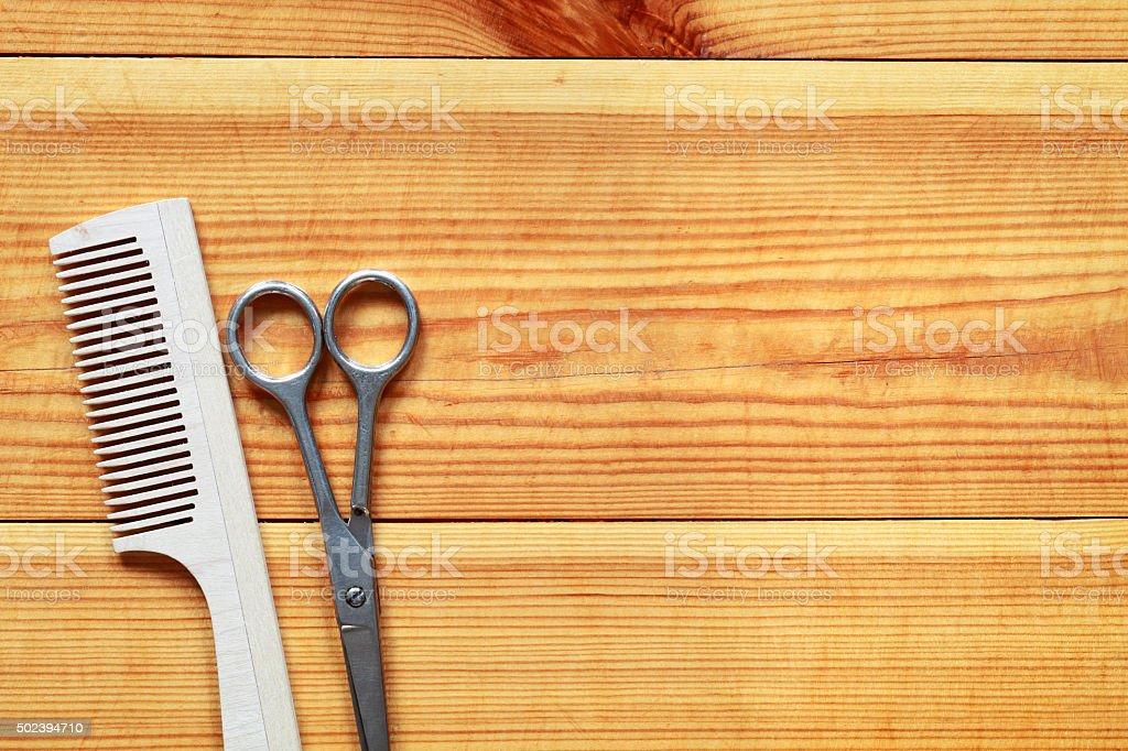 Scissors and hairbrush stock photo