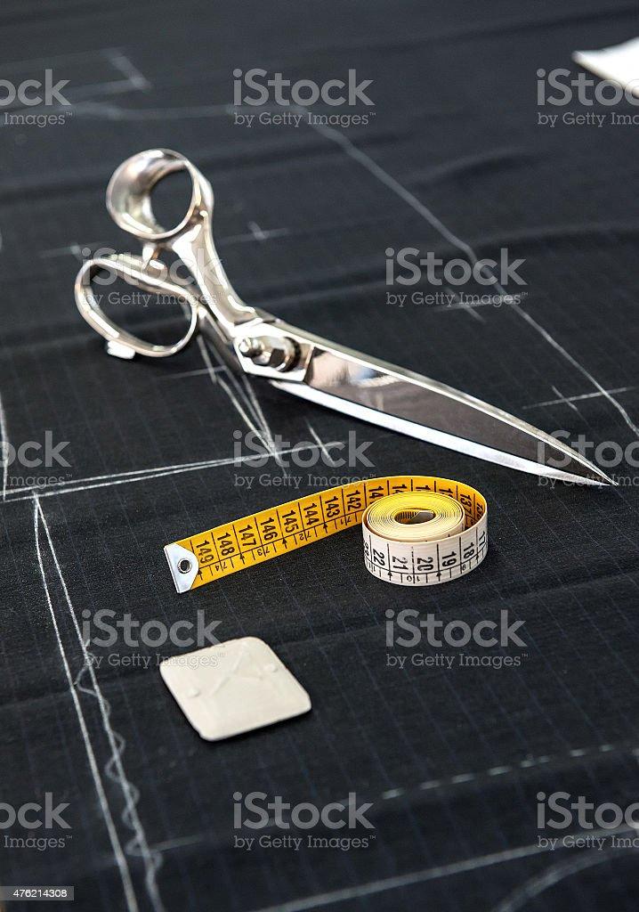 Scissors and Tape Measure on Fabric in Studio stock photo