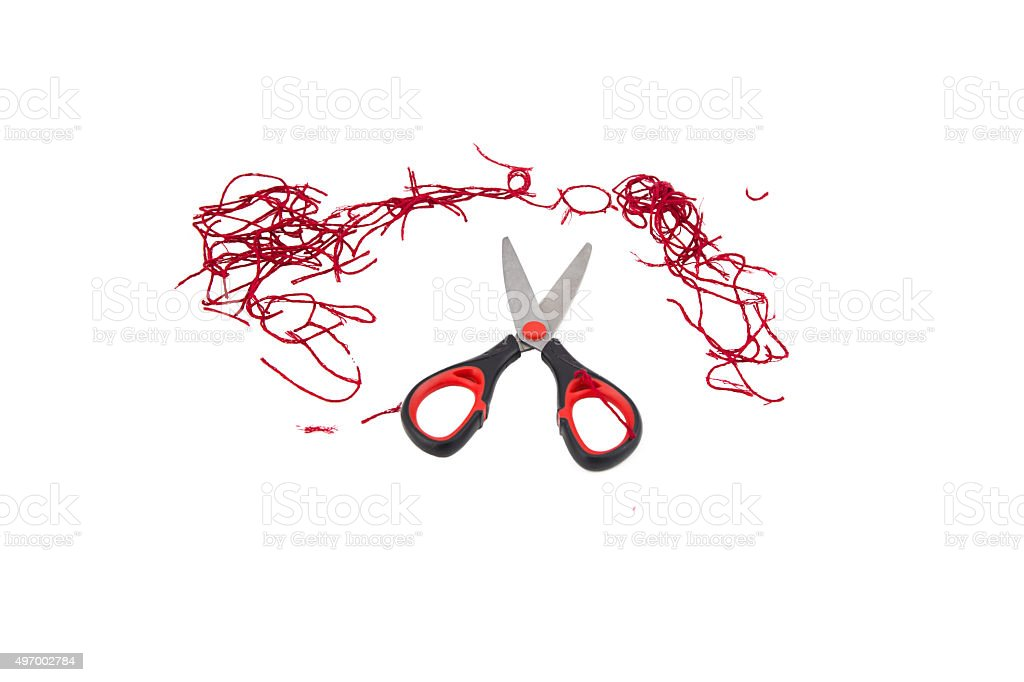 Scissors and thread  on white stock photo