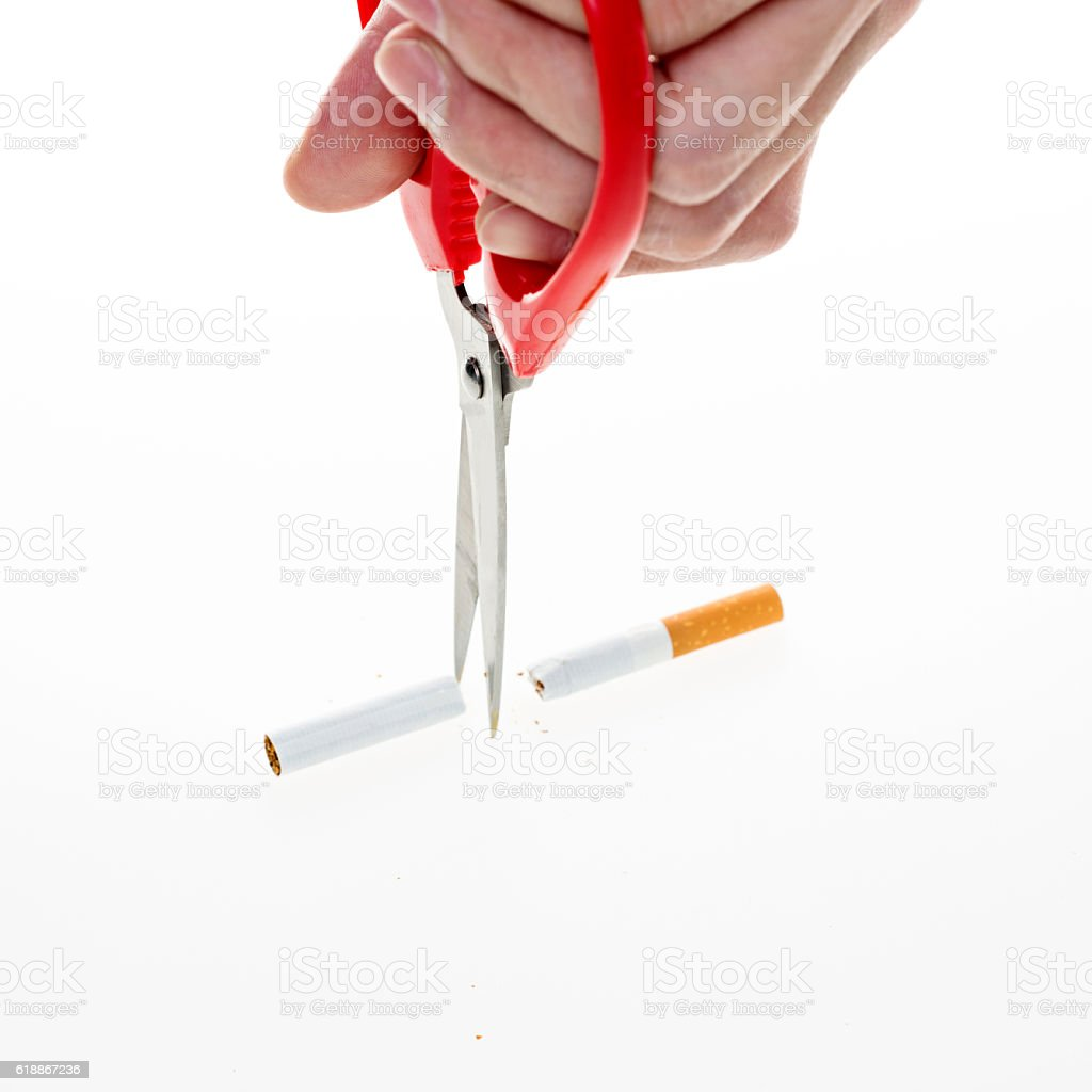 scissors cut a cigarettes stock photo
