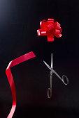 Scissors cut bow of tape